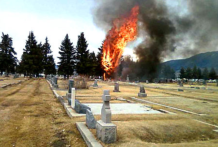 This picture taken by eyewitness Martha Guidoni with her cellphone and provided by the Montana Standard shows a small, singe-engine plane bursting into flames in Holy Cross Cemetery on March 22, 2009 just south of the Bert Mooney Airport in Butte, Montana. All 17 people on board were killed, many of them children heading on a skiing holiday, federal aviation officials said. The plane, a single engine turboprop, was heading from Oroville, California, just north of San Francisco on a 900-mile (1,500-kilometer) journey to Bozeman, Montana. EDS NOTE: Best quality available.         AFP PHOTO/Martha Guidoni via the Montana Standard/HO          ++RESTRICTED TO EDITORIAL USE - MANDATORY CREDIT: MARTHA GUIDONI VIA THE MONTANA STANDARD++ (Photo credit should read MARTHA GUIDONI/AFP/Getty Images)