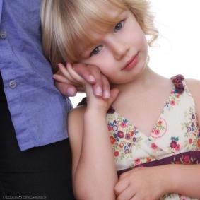 istock_careyhope-1-shy-child-holding-mothers-hand-c