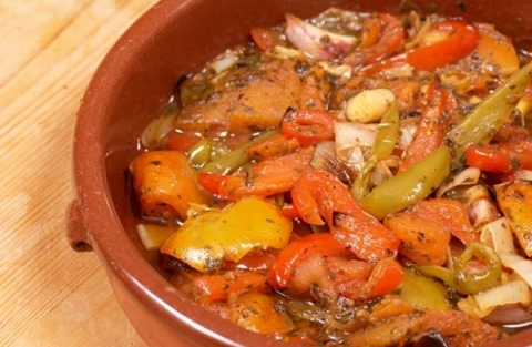 Vegetables in a clay pot with cover. jpg